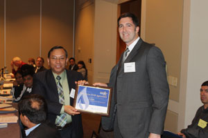 Scott Bartos (U.S. EPA's Natural Gas STAR Program) giving A.K. Hazarika (India's Oil and Natural Gas Corporation Ltd) a certificate of appreciation at the GMI Oil & Gas Subcommittee meeting.